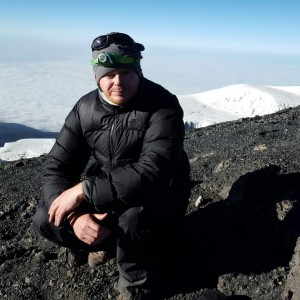 David Humphries atop Mount Kilimanjaro