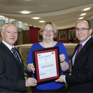 Padraic O'Connor Building Services Department Manager Ireland with Ruth Riordan Sisk Energy Co-ordinator receiving the ISO50001 award from John White, Business Development manager BSI Ireland.